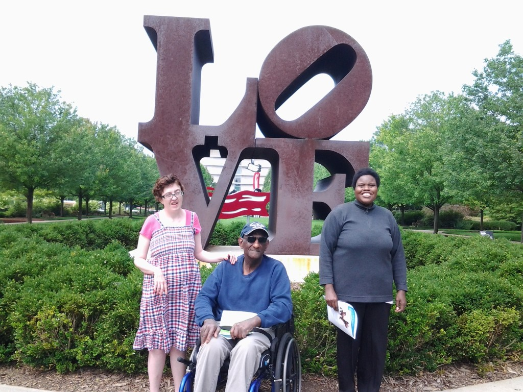 "Three Noble participants in front of the ""LOVE"" sculpture at the IMA."