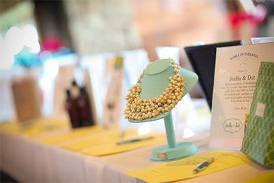Noble Golf Classic auction table with a necklace on display.