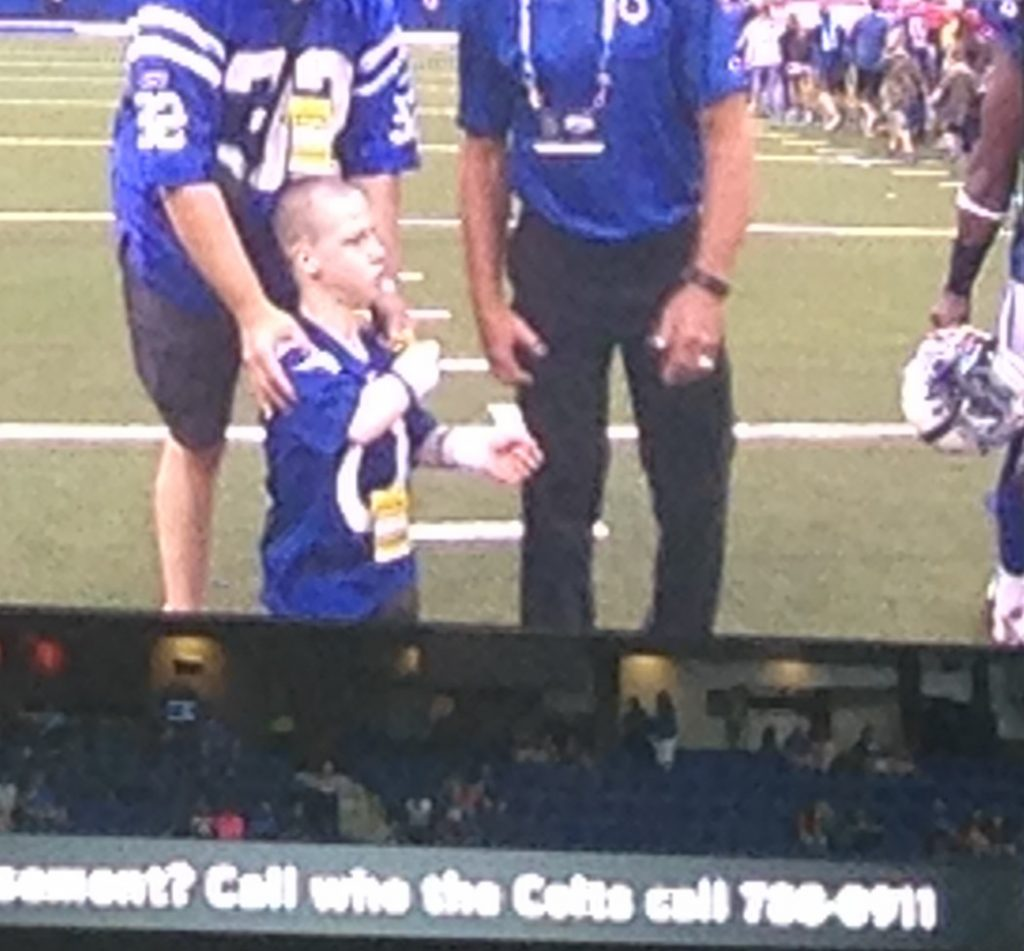 Robbie threw the ceremonial coin to open the Aug. 31 Colts game