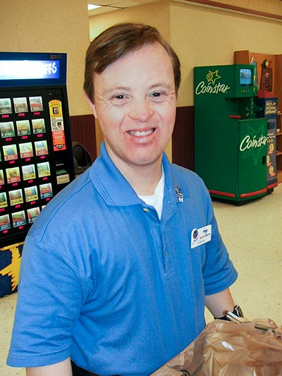 Noble participant, Justin Graves, at his job at Kroger.