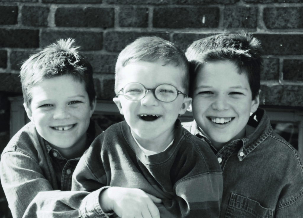 Although they are all grown up now, Kyle enjoys a special bond with his brothers