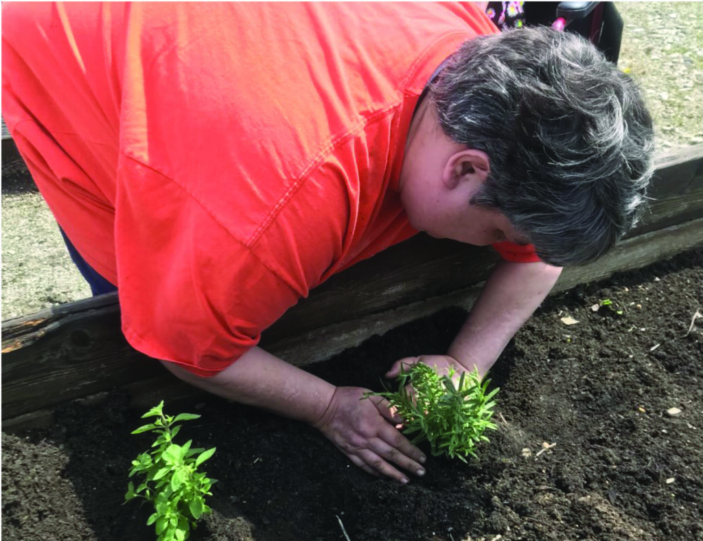 Sarah is exercising her Green Thumb in our Giving Sum Garden