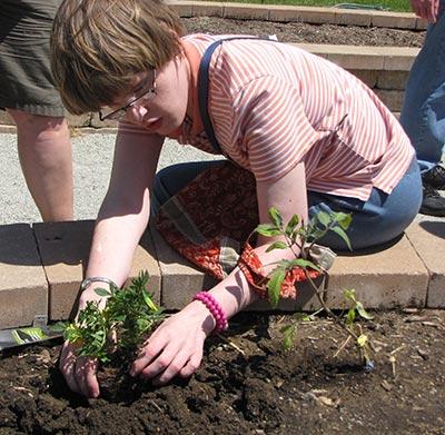 Liz gardening in our Giving Sum Garden.