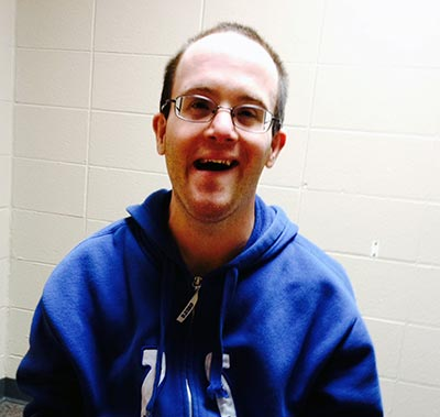 Nathan smiling for the camera wearing a Colts sweatshirt.