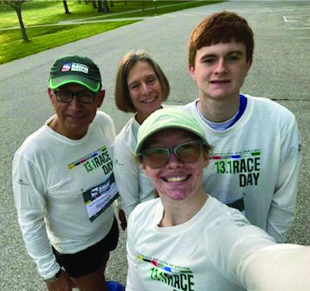 James runs his first Mini Marathon with help from his Noble staff